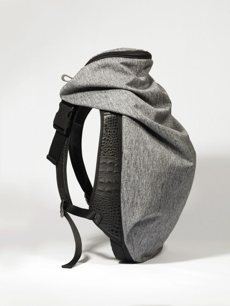 Researching bags for my bag/top multi-funcitonal garment idea. A bag could be intergrated into a top like a rucksack on your back. The draped fabric on this rucksack makes  it feel more like a garment.