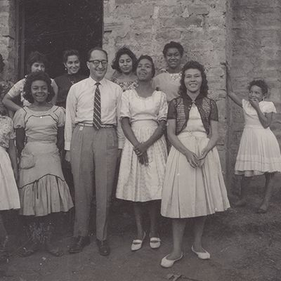 Héctor Abad Gómez (middle) along with some rural health promoters, 1965