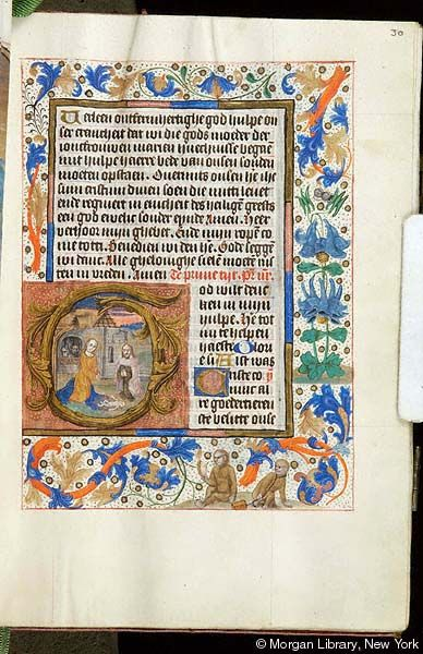 Book of Hours, MS S.1 fol. 30r - Images from Medieval and Renaissance Manuscripts - The Morgan Library & MuseumChrist: Nativity -- Virgin Mary and Joseph the Carpenter, both with rays as nimbus, both kneel with joined hands flanking nude infant Christ Child, emanating rays, laying on ground on Mary's mantle. In background is stone barn with thatched roof, with man (?) and ass in arched window. Scene in decorated initial G. Margins with vinescroll and floreate ornament.