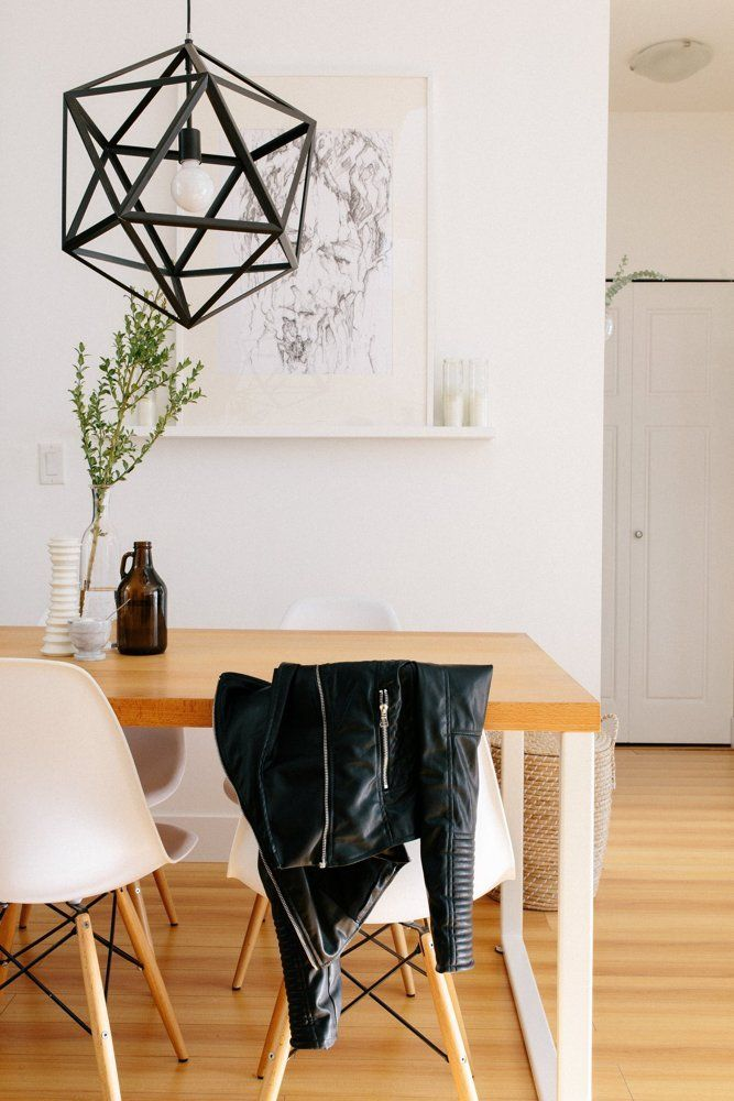 Loving the geometric light fisture in Dani and Dave's Scandinavian Minimalist Home — House Tour | Apartment Therapy