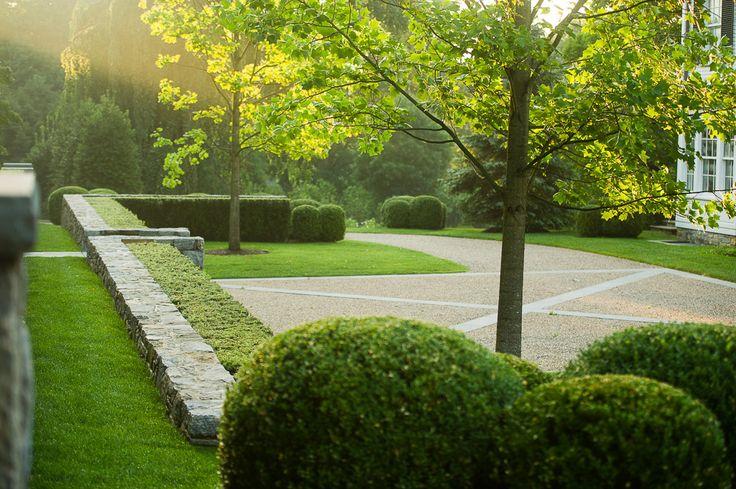 Hedges along stone walls by Doyle Herman Design Associates Landscape Design
