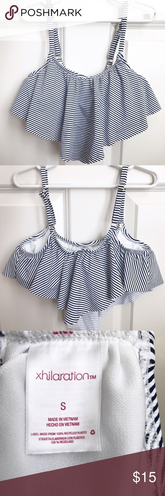 Navy & White Stripped Flounce Bikini Top NEVER WORN - Navy and white flounce bikini top. It has adjustable straps and also comes with removable pads!! Very cute and is no longer online or in Target stores!! Xhilaration Swim Bikinis