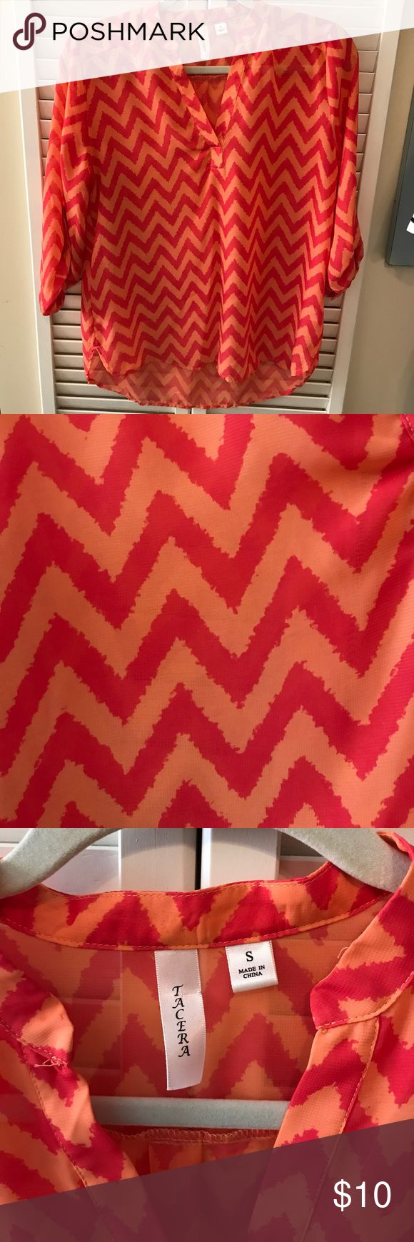 Tacera poly dress top. Size small. Tacera polyester dress top. 3/4 sleeves with a button. Full length when dropped. Pink and orange chevron. Size small. tacera Tops Blouses