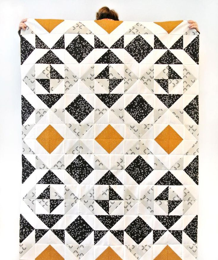 You can make this quilt or others like it using the Nordic Triangles Quilt Pattern! Found at suzyquilts.com/shop