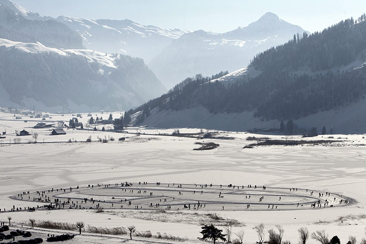Switzerland: People skate on the frozen Sihlsee lake, in the Euthal valley