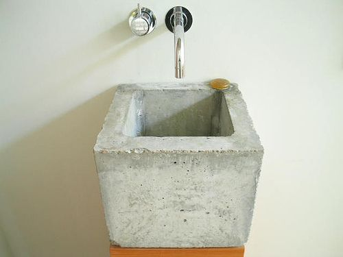 A simple concrete wash basin by Heike Muehlhaus in Germany.