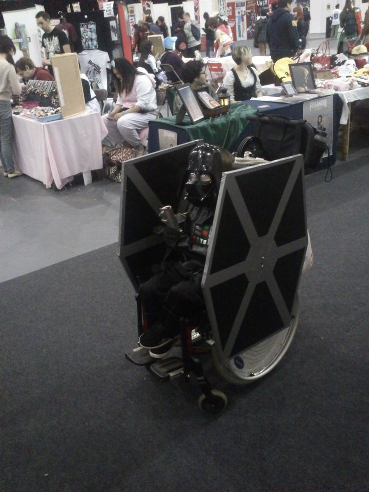 """The Force is strong with this one"" - Fantastic Darth Vader Tie Fighter wheelchair costume."