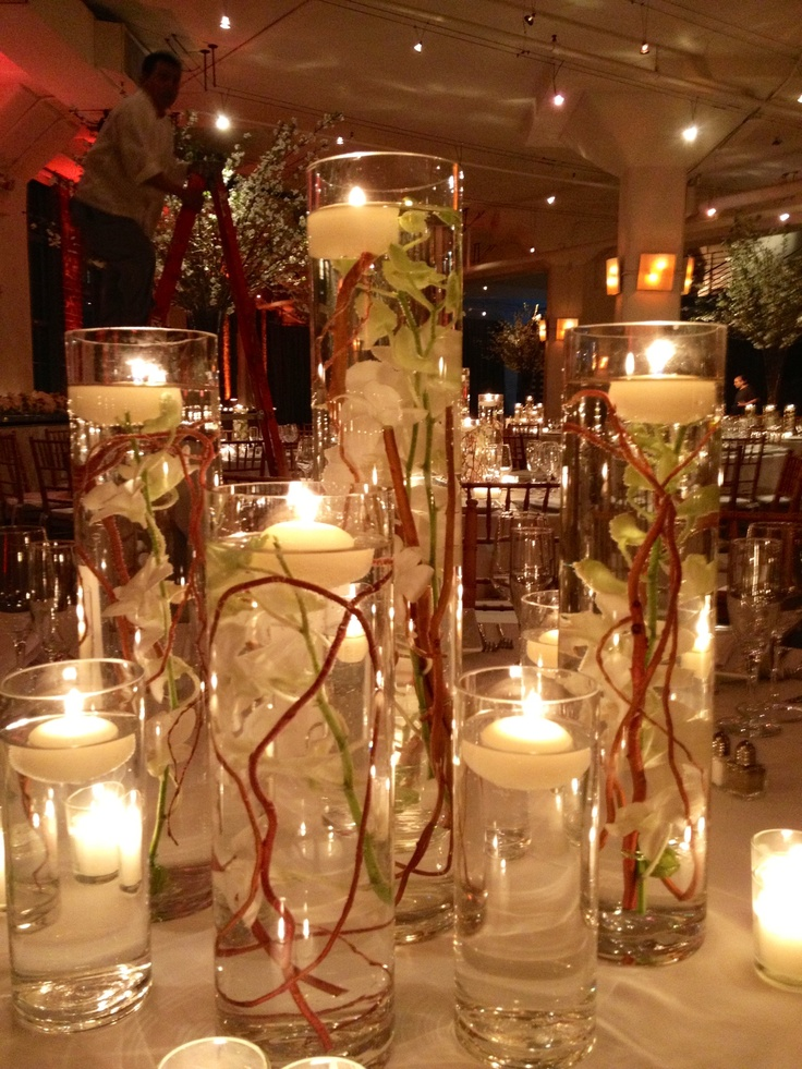 1000 images about floating candle centerpieces on for Candles for wedding tables decoration