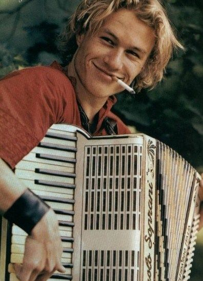 Heath Ledger, sadly missed.  Not many men can rock an accordion  and a cigarette and still look this cool!