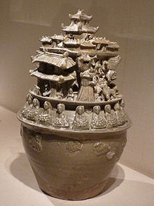 A Jiangnan funerary jar from ca. 250-300 AD, decorated with a row of Buddhas seated on lotus-petal thrones, said to be one of the earliest examples of Chinese Buddhist art.[