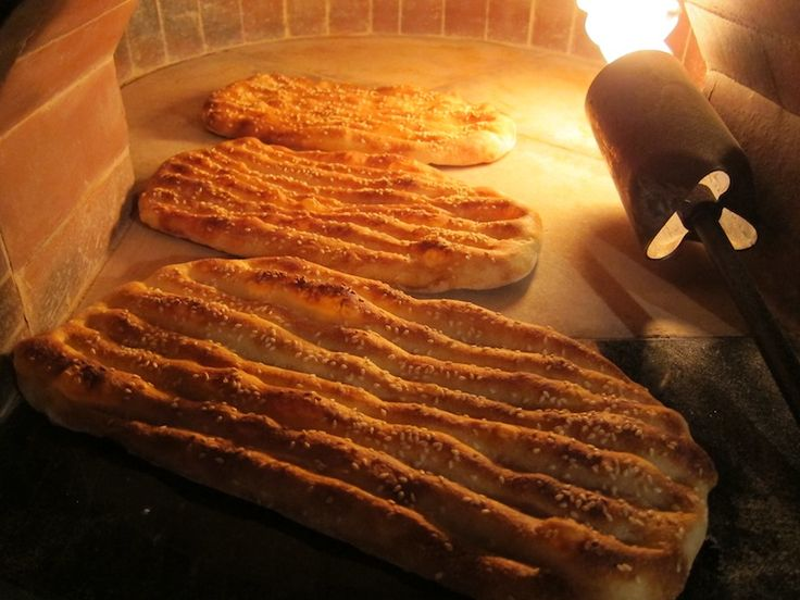 Barbari breads in the process of baking inside the oven