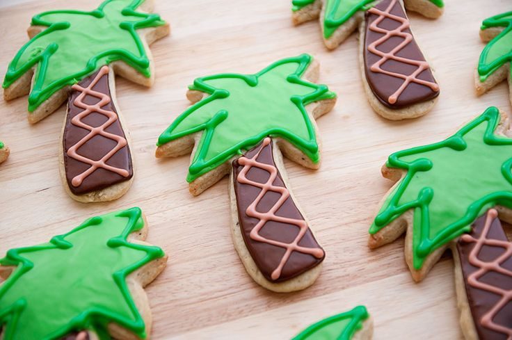 Palm tree decorated sugar cookies. Royal icing. Green, brown.