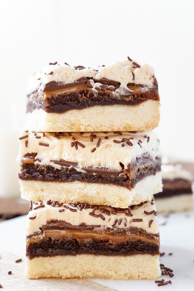 Billionaire Bars - Made with 5 glorious layers of RICH and DECADENT sugary favorites! Shortbread, brownie, caramel, chocolate, and peanut butter frosting combine for the ultimate dessert bar!