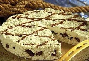 Tradisjonsrik dravle fra Voss (også omtala som rauddravle).  (Bildet viser en kake på dravle, men Vossadravle er rødbrun i fargen, klumper som ligger i laken)