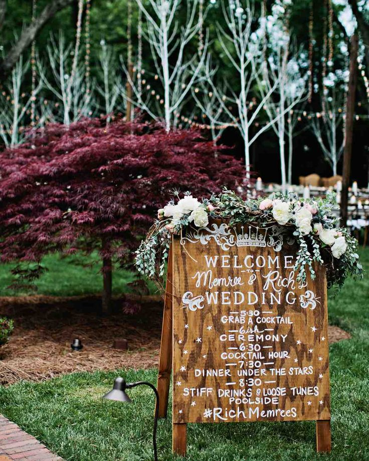 A Tennessee Wedding at the Couple's Log Cabin Home | Martha Stewart Weddings - After entering through the driveway, guests saw this hand-painted wooden sign lettered by Tenn Hens that served as the evening's itinerary. Memree and Rich opted for two cocktail hours, one before the ceremony and one immediately after.