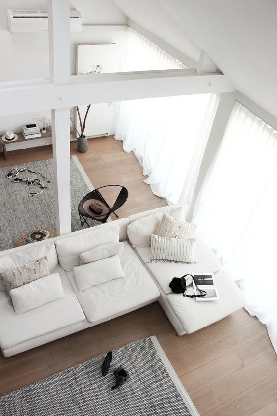 white sofa and sheer curtains