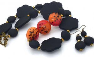 Matt Black Beaded Necklace with three hand painted wooden focal beads,  accented with gold plated glass beads - is designed and made in Australia,   Just $34.95