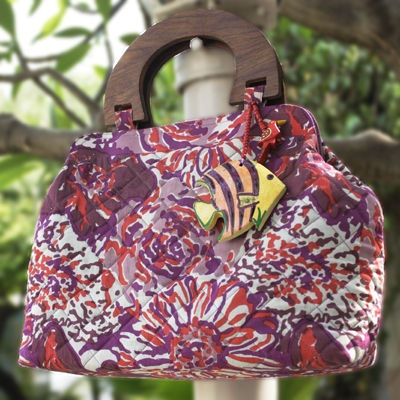 Bright coloured quilted bag.
