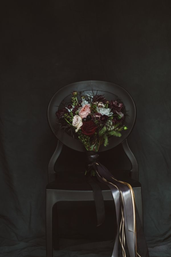Moody winter bouquet wrapped with black and metallic ribbons   Photo by Jessica Connery Photography