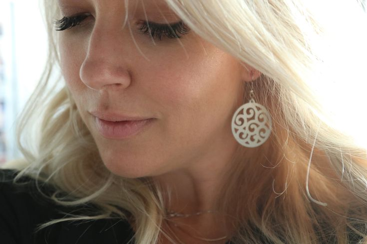 Bailey Schneider wearing laser cut earrings by The Design Tree