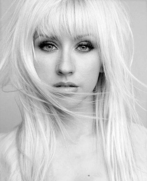 Christina Aguilera platinum blonde straight hair. Black and white photo