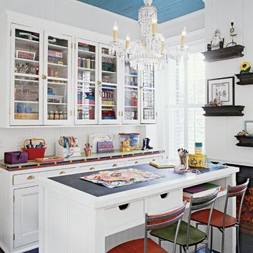 Built-In Craft Storage - My current craft storage and room is my entire little apartment in various piles of projects and boxes. This craft and sewing room would be in my Dream House because it is extremely organized, clean, bright and elegant. LOVE IT! WANT IT NOW!