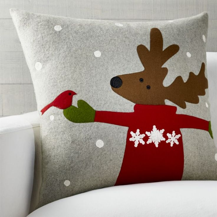 Shop Donner Reindeer Pillow.  Dressed in a cozy winter sweater, a friendly reindeer celebrates a snowy day on our delightful felt pillow designed by Joan Anderson.  Created with appliqué and various embroidery techniques, the pillow reverses to solid grey.