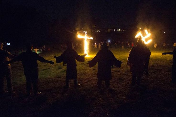 Ku klux klan supporters do nazi salutes at rally in honour of donald