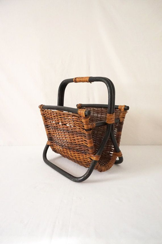 This vintage black rattan and natural wicker magazine rack has great retro Asian style. Very solid and totally usable.  The rack is in excellent