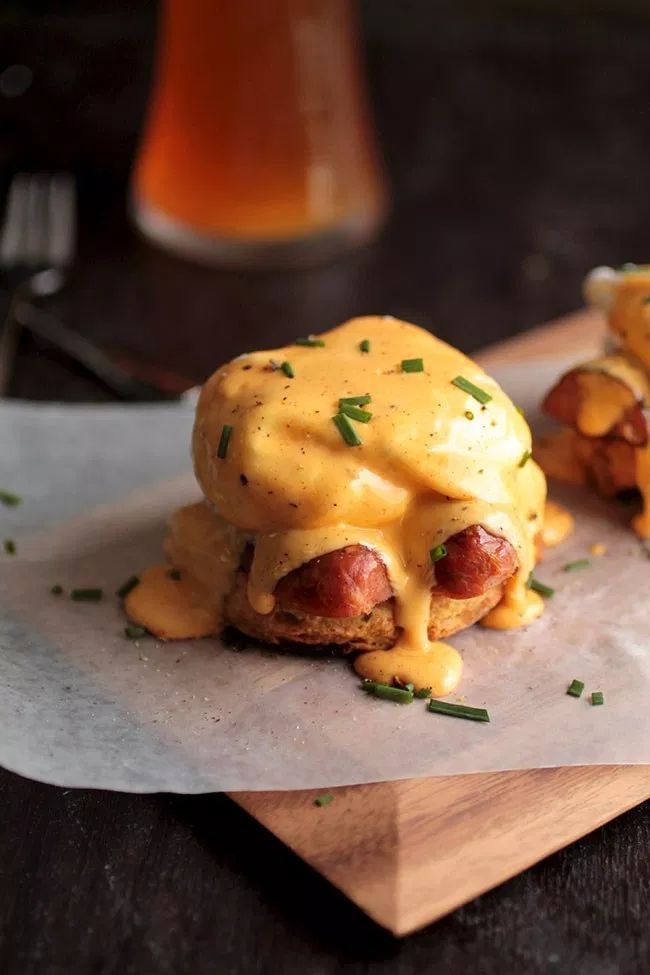 A cajun inspired eggs benedict recipe perfect for brunch! A spicy two-minute homemade hollandaise sauce, poached eggs, and andouille sausage on top of a cheddar beer biscuit. Mexican Breakfast Recipes, Savory Breakfast, Breakfast Dishes, Best Breakfast, Breakfast Ideas, Brunch Ideas, Second Breakfast, Breakfast Sandwiches, Breakfast Pizza