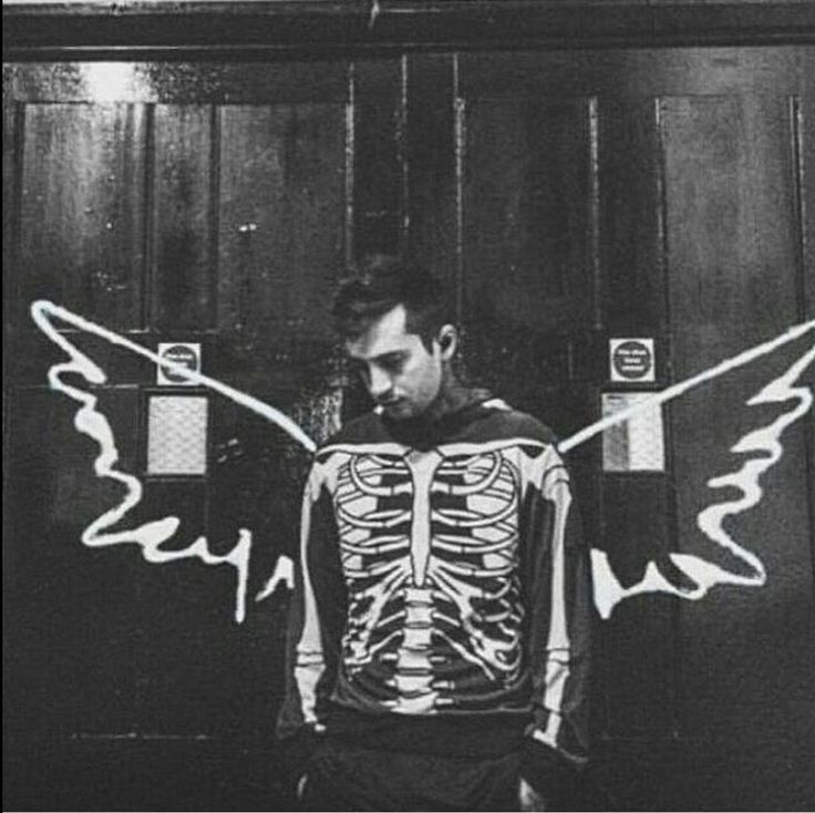 It's a pic of Tyler Gideon with the wings from the new The Script album