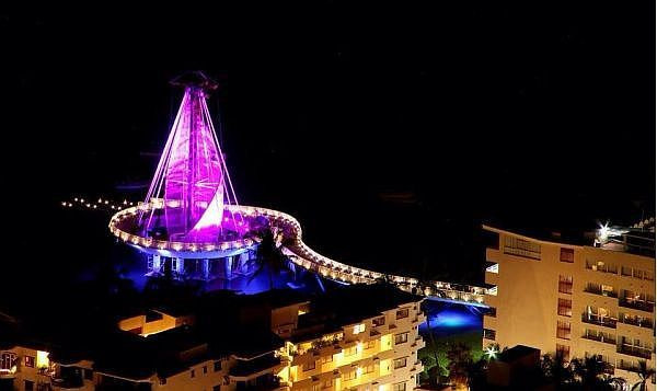 "The new Los Muertos pier consists of a sixty-five meter walkway, with railings and lighting for safety, that leads to a roundabout with a ""sail"" at its center. Multi-colored lights illuminate the sail and shine over the water, adding to the pier's ambiance during the evening hours. More info on Puerto Vallarta gay attractions and activities: www.discoveryvallarta.com/guide.html  #vallarta #gay #travel #destinations #attractions #beaches"