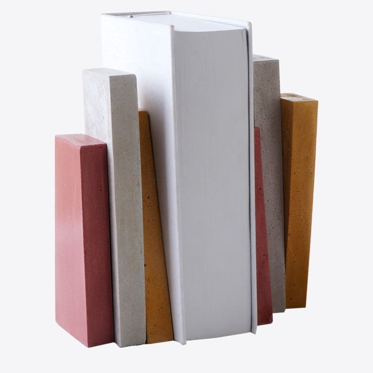 Handmade concrete book stands in geometrical shapes by We design.