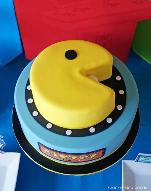Pac Man two tier cake. Could use buttercream instead of fondant, too.