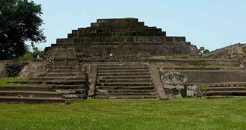 Structure 5, the Toltec style pyramid in Tazumal, in Chalchuapa, El Salvador. Also known as La Campana or the bell, it was constructed at the end of the Classic Maya period in 900AD, and then reconstructed and covered by concrete in the 40's and now being restored. This pyramid faces a large game court, and as such likely represents the main structure of Tazumal