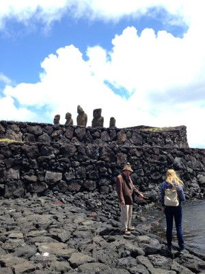 Paul from Tekarera Inn showing me special lava rocks used for carving Moai statues