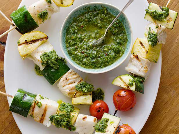 Fish Skewers with Basil Chimichurri from FoodNetwork.com. I love Melissa's Recipe's.  Great Summer grill recipe (grow basil, parsley, small tomato, and zucchini)