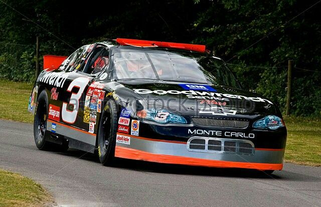 2000 Chevrolet Monte Carlo NASCAR with driver Taylor Earnhardt at Goodwood Festival of Speed, Sussex, UK