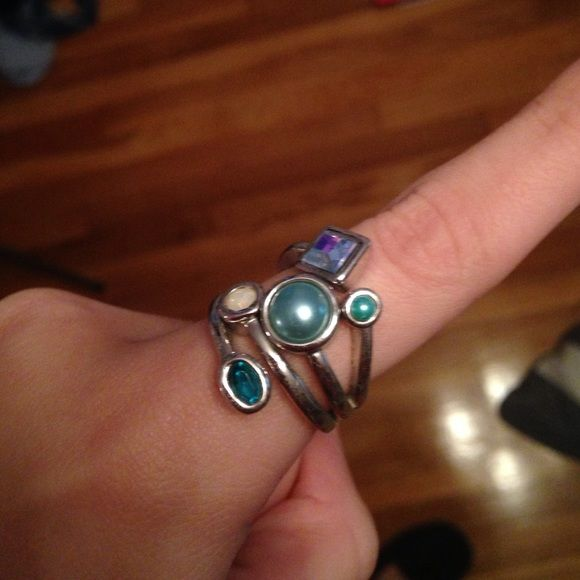 Blues lia Sophia ring! Great condition! Lia Sophia ring! Unique with different shades of blue! You will get so many compliments on this peice! Lia Sophia Jewelry Rings