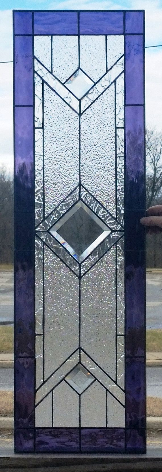 These elegant stained glass cabinet inserts were made for our customers kitchen.  Size: 12 x 32. Can be customized and colored to match you decor. For this piece we used grape waterglass for the border, different clear textures and beveled glass for the diamonds.  -------------------------------------------------------------------  All of our windows and panels come with metal frames. We now offer custom wood framing for an additional charge. Frames are made to the thickness and finish you…