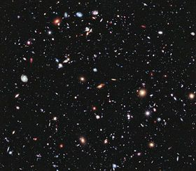 Cosmology - The Hubble eXtreme Deep Field (XDF) was completed in September 2012 and shows the farthest galaxies ever photographed by humans. Except for the few stars in the foreground (which are bright and easily recognizable because only they have diffraction spikes), every speck of light in the photo is an individual galaxy, some of them as old as 13.2 billion years; the observable universe is estimated to contain more than 200 billion galaxies