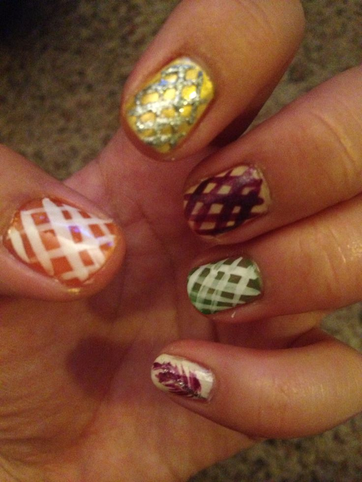 Thanksgiving/autumn design Tips/what you need: •L.A. colors green, orange,(Ross Bows & Bling designer nail gem collection pack)  &  light brown nail color (Dollar Tree) •Pure Ice Yellow (walmart) •White Nail color (walmart) •L.A. Colors purple & white nail art lacquer (Dollar Tree) •Kiss Nail Art Paint Silver (walmart Trio Pack) •Sally Hansen Advanced Hard as Nails Strengthener (Target) Directions: Apply Strengthener to nails first, Apply desired color nail polish to each nail, apply…