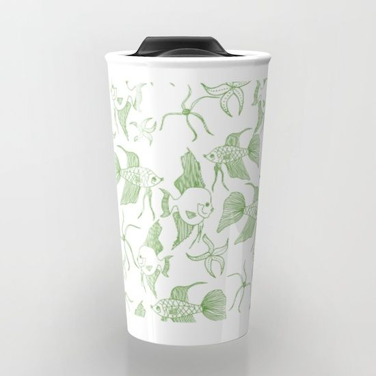 "Greenery fish travel mug $24.00 Take your coffee to go with a personalized ceramic travel mug.  Double-walled with a press-in suction lid, the two-piece (12oz) design ensures long lasting temperatures while minimizing the risk of spillage from kitchen to car to office. Standing at just over 6"" tall with wrap around artwork, safely sip hot or cold beverages from this one of a kind mug."