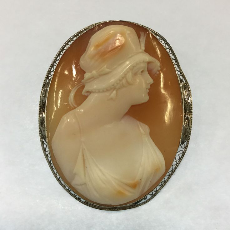 Perfect for the Art Deco lover in your life.  #cameo #artddecofashion #conchshell