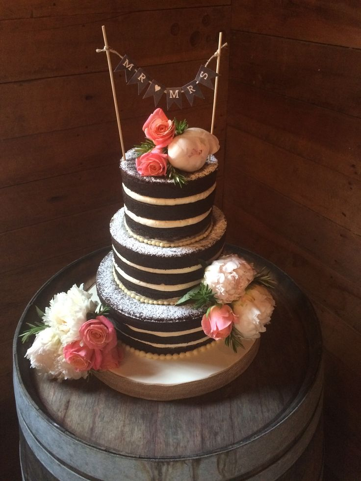 Naked cake, chocolate with buttercream icing though the centre. Thanks to Carmen's Cakes http://www.carmenscakes.com