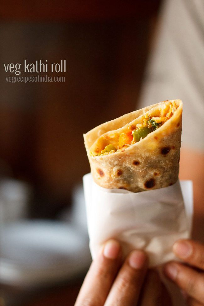 Veg Kathi Rolls Recipe - Delicious wraps stuffed with a spiced mix veg stuffing.