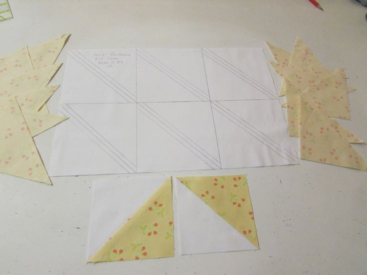 "Ernest B. Haight's (My Hero) grid for HST's produces a ""Dynamic Dozen"" of perfect HSTs.  We worked on a rectangle of 10"" X 15"" (6x5"" Grids) with only 8 x seams.  Diagonal corner to corner (C2C) cutting lines are drawn and 1/4"" seam lines are added on each side.  2 of the C2C lines cut across 4 x grids and the remaining 2 x C2C lines cut across the remaining end singular grids.  After sewing the outer ""tram lines"" aka seam lines the grid is dissected along the cutting lines and Voila!!!"