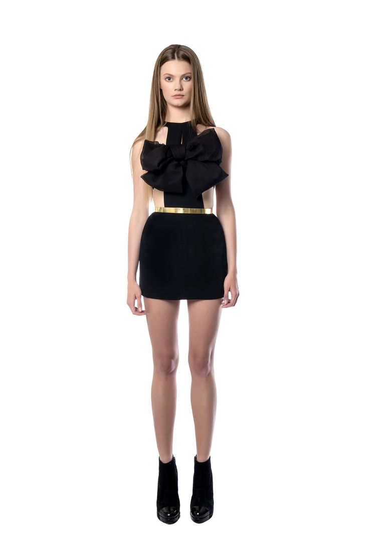 Mini black crepe dress  Special black mini dress made of crepe material with a thin cut neckline which is covered by a bow detail on the upper area. May be worn with black booties and a jacket on the cooler nights of the fall, forming a perfect outfit for a special occasion.