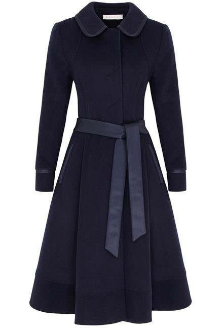 Fifties Style Wool Cashmere Coat. A beautiful Italian cloth winter coat. Immaculately tailored into our signature fifties style. The coat falls below the knee and has a beautiful drape and wonderful presence. Trimmed in a magical silk blend cloth, which is beautiful yet durable. The coat is a wonderful piece for the day and yet special enough to be worn as a chic outer layer to a winter event or wedding.  The coat makes you feel absolutely and totally dressed.
