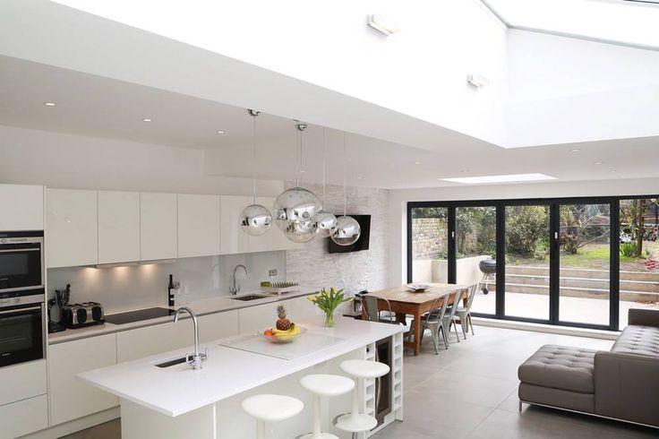 All white kitchen island design in high gloss lacquer kitchen finish. #whiteglosskitchen #whitekitchenisland